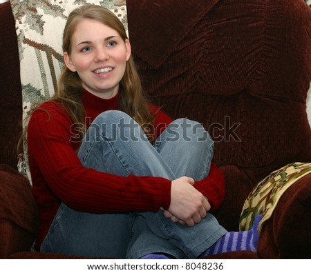 Young lady relaxing on chair - stock photo