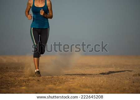 Young lady running in the desert
