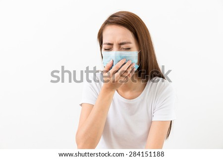 Young lady sneeze with face mask - stock photo