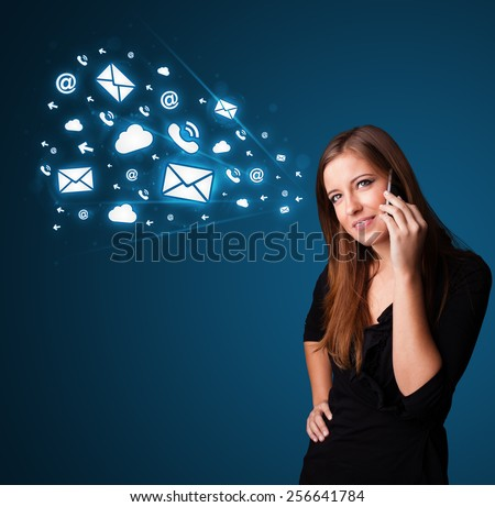 Young lady standing and making phone call with message icons - stock photo