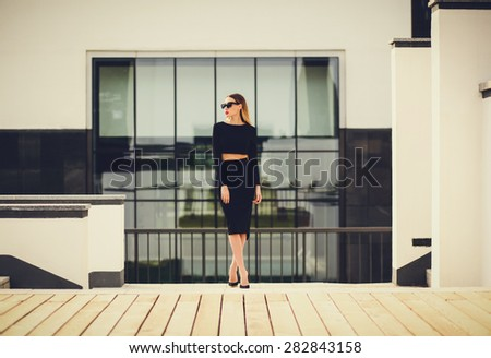 young lady standing near the business center. looking away. copy space