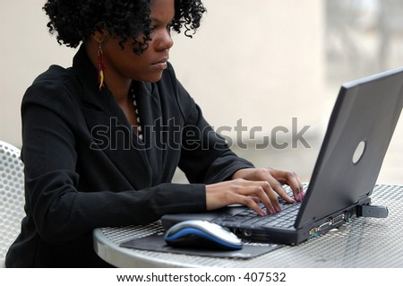Young lady typing on the computer