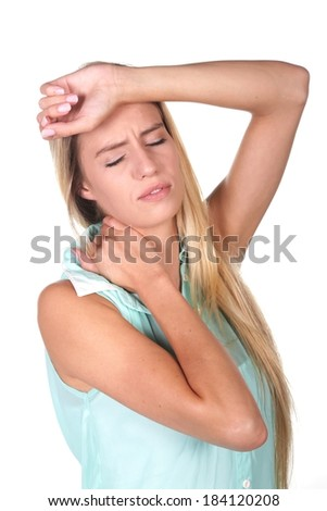 Young lady with migraine headache and sore neck with hand on forehead