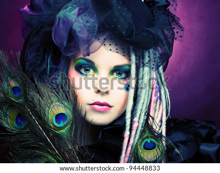 Young lady witn creative make-up in vintage hat - stock photo