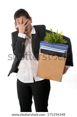 Young Latin Business Woman with Ponytail  carrying in stress her office belongings in Cardboard Box Fired from Job looking Sad and Desperate isolated on White Background - stock photo