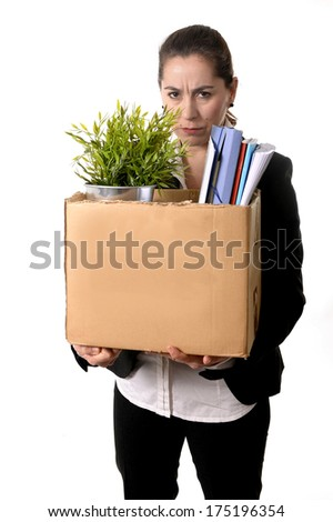 Young Latin Business Woman with Ponytail  carrying in stress her office belongings in Cardboard Box Fired from Job looking Sad and Desperate isolated on White Background