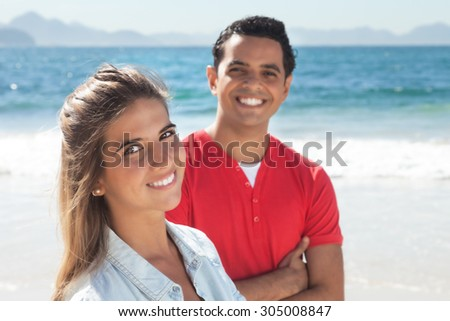 Young latin couple at beach