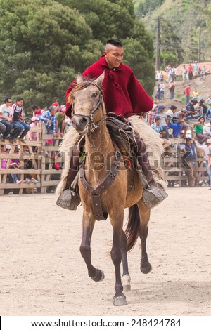 Young Latin Cowboy Learning To Ride A Horse, South America Competition  - stock photo