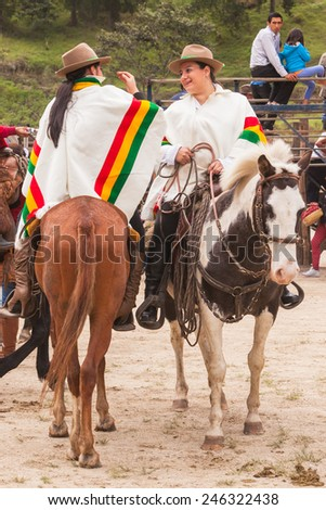 Young Latin Cowgirls Riding Horses Dressed With Elegant White Poncho, South America  - stock photo