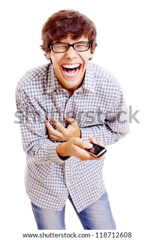Young latin man in black glasses and mobile phone in his hand doubling up with laughter. Isolated on white background, mask included - stock photo