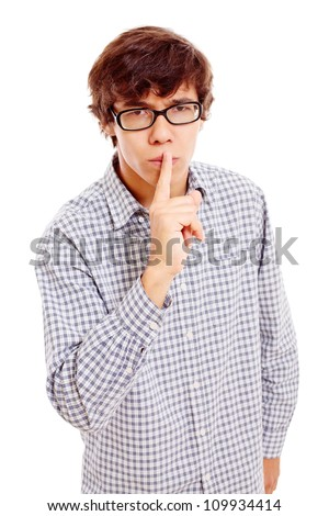 """Young latin man in black glasses showing """"silence, please"""" gesture. Isolated on white background, mask included - stock photo"""