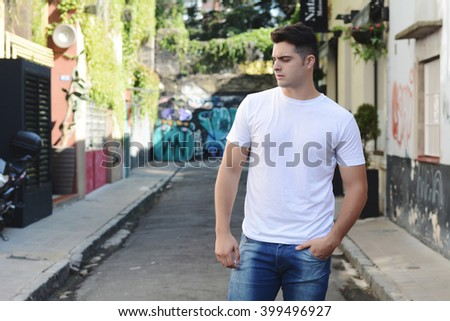 Young latin man posing on the street