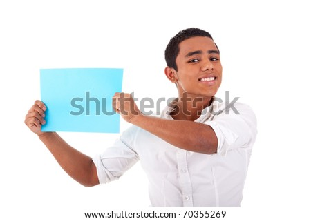 young latin man, with blue  card in hand, smiling, isolated on white background. Studio shot. - stock photo