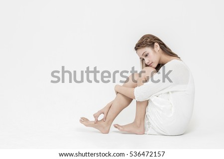young latina girl sitting on the white floor