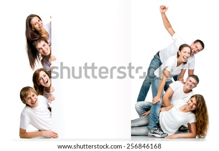 young laughing people looking out a white board - stock photo