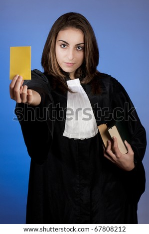 young lawyer (judge) showing a yellow card - stock photo