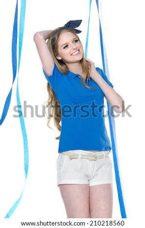 young leisure woman in shorts with blue ribbons posing