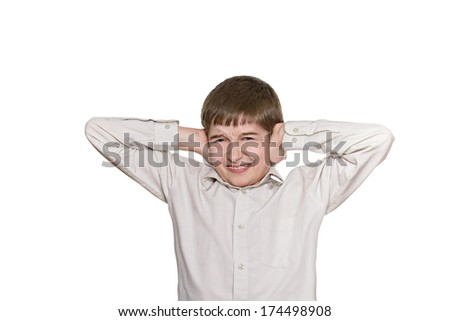 young little boy doing facial expressions - stock photo
