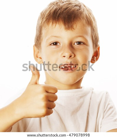 young little boy isolated thumbs up on white gesturing