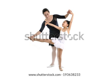 young little girl ballerina learning dance lesson with female ballet teacher