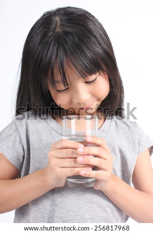 Young little girl drinking water.  - stock photo