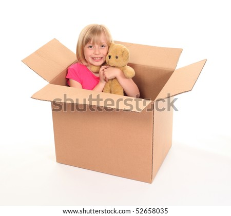 Young little girl sitting inside box with teddy bear