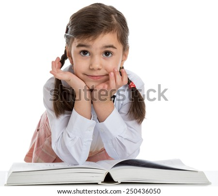 young little girl with a big book on white background - stock photo
