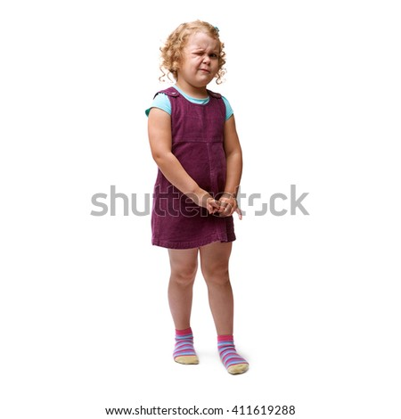 Young little girl with curly hair and one eye closed in purple dress standing over isolated white background - stock photo