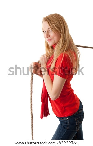 young, long hair, woman pulling grey rope, tug-of-war - stock photo