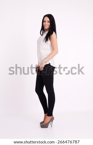 Young long-haired black-haired woman posing in studio