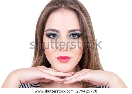 young long haired blond girl posing with hands under her chin isolated over white - stock photo