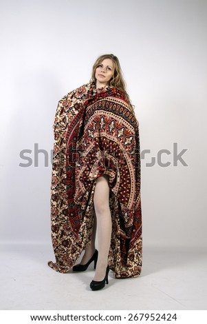 Young long-haired curly blonde woman posing wrapped in a mandala - stock photo