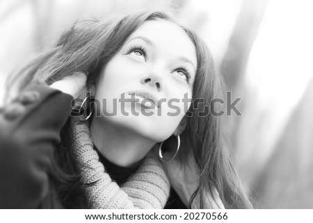 Young looking up woman portrait. High key colors. - stock photo
