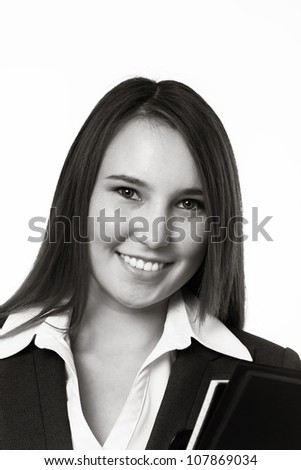 young looking woman wearing a suit looking at camera - stock photo