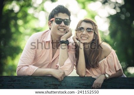 young love couple and girl walking in the park - stock photo