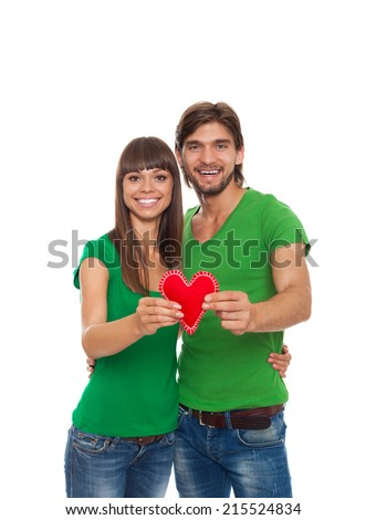 young love couple holding red heart, happy smile embrace, isolated over white background, valentine day concept - stock photo