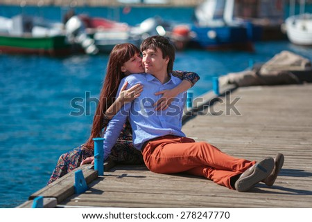 Young love couple hugging by the sea background - stock photo
