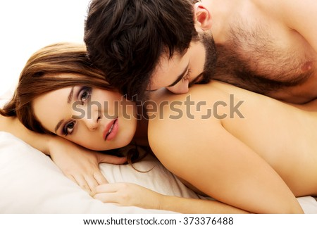Young love couple in bed. - stock photo