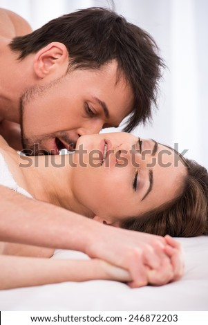 Young love couple in bed  romantic scene in bedroom. Young Love Couple Bed Romantic Scene Stock Photo 246872203