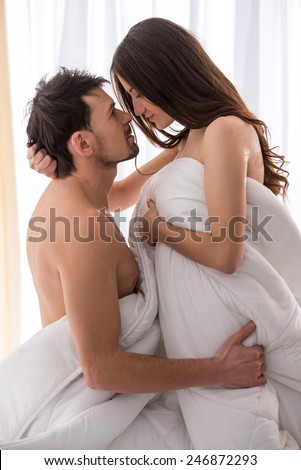 Young love couple in bed  romantic scene in bedroom. Young Love Couple Bed Romantic Scene Stock Photo 246872293
