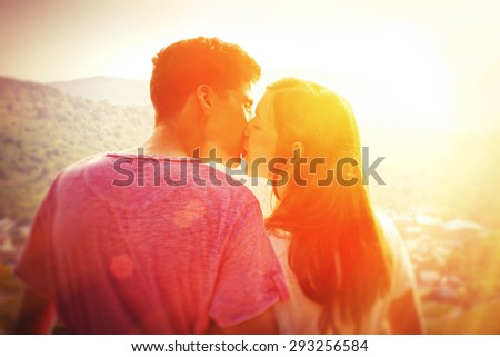 Young love couple in the sun - stock photo