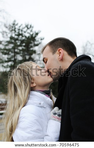 Young love couple kissing in a city
