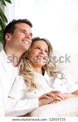 Young love couple smiling in the comfortable apartment - stock photo