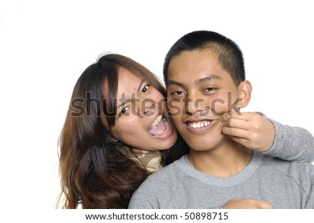 Young love couple smiling. Over white