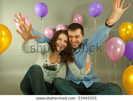 Young love Couple smiling with balloons - stock photo