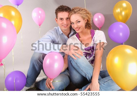 Young love Couple smiling with balloons