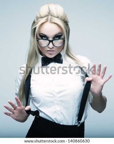 Young lovely blond woman with glasses posing in studio - stock photo