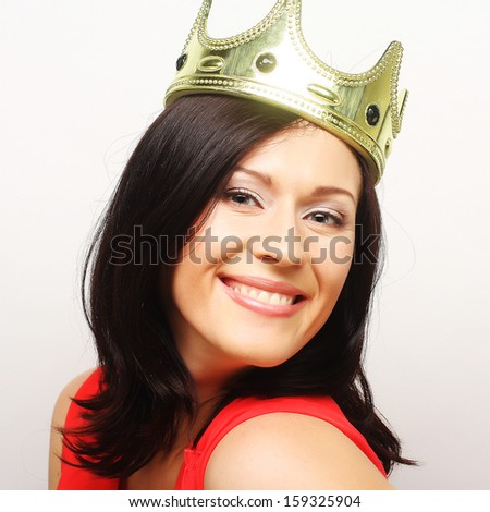 young lovely brunette woman in crown - stock photo