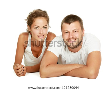 young lovely couple lying on the floor, isolated on white background - stock photo