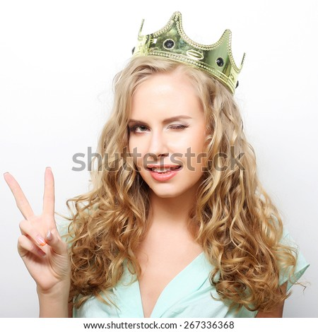 young lovely expression woman in crown - stock photo